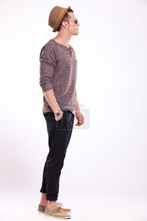 relaxed man holding hand in pocket