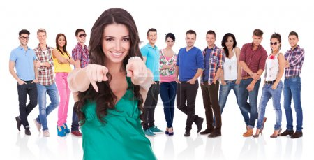 Photo for Young casual woman choosing you for her team by pointing her finger - Royalty Free Image