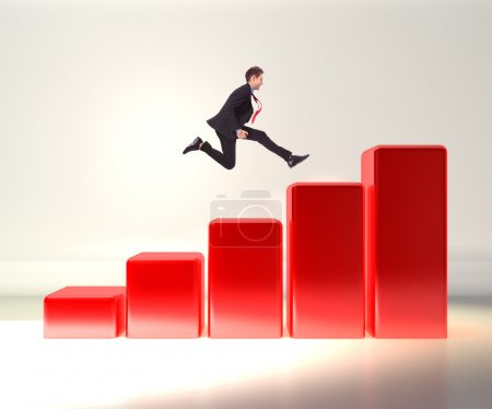 Photo for Winning business man jumping o top of a 3d graph - Royalty Free Image