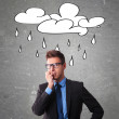Worried office worker with a cloud drawn on a blac...