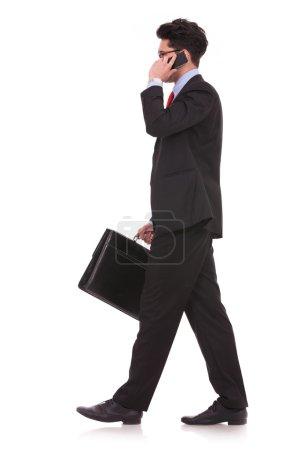 walking to side & talking on phone