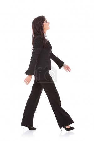 business woman walks to side