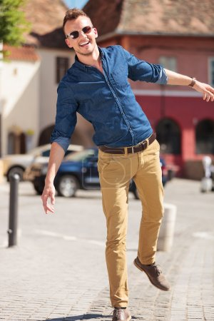 casual man balancing in city