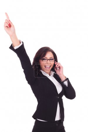 Photo for Young business woman cheering while speaking on the phone. on white background - Royalty Free Image