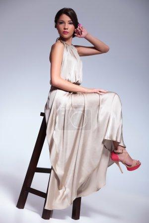 beauty woman posing on a high stool