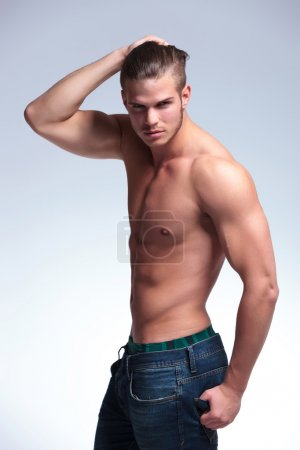 side view of a topless young man