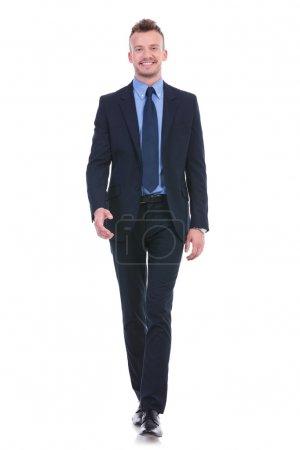 Business man walks towards the camera