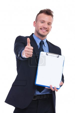 business man showing clipboard and thumbs up
