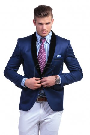 young business man taking suit jacket off