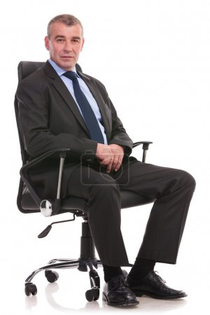business man sits on an office chair