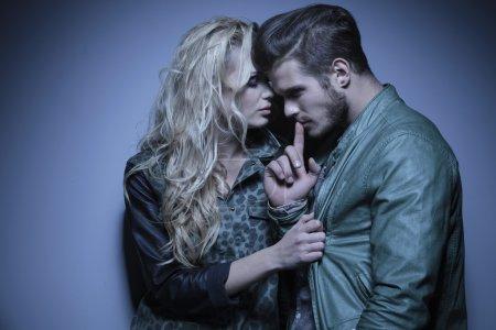 woman embracing her thoughtful boyfriend