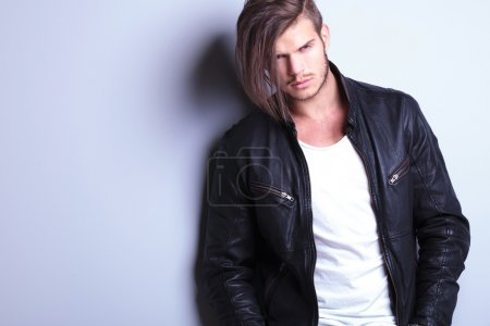 unshaved young fashion model in leather jacket