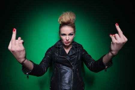 young woman in leather jacket is flipping you off