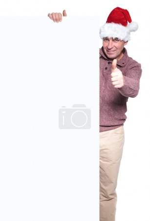 Man in santa hat with big blank board and making the ok sign