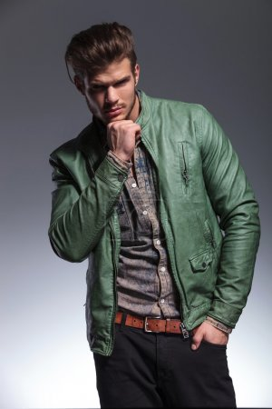 Thoughtful fashion man in leather jacket