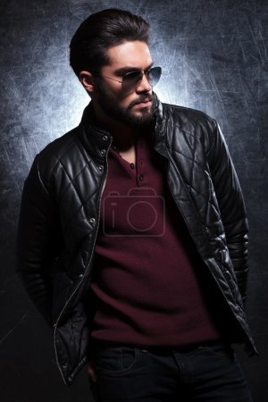 side of a fashion man in leather jacket and sunglasses
