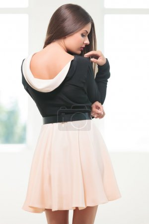 young fashion woman looks at her shoulder