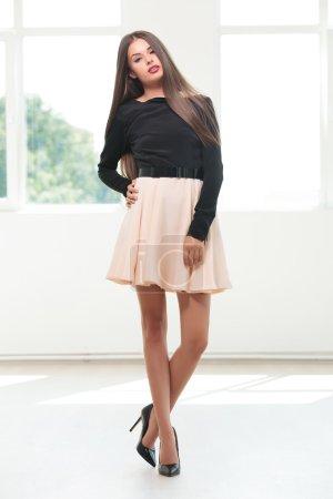 young fashion woman posing in studio