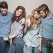 Men and women standing together in casual jeans cl...
