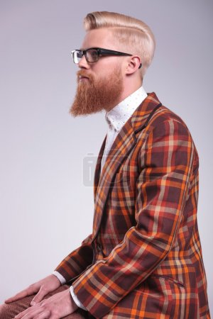 side view of a young fashion man with long beard