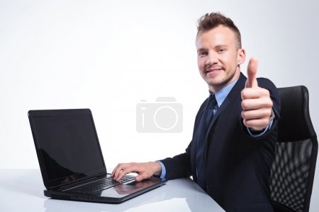 Business man shows you the thumb up