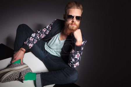 bearded man with hand on chin