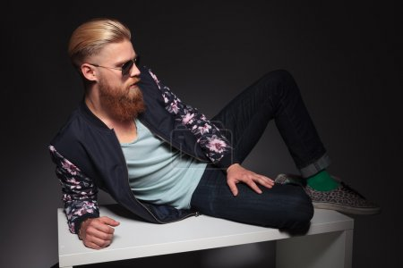 bearded man relaxes in studio