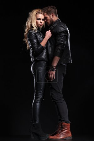 Photo for Full length picture of a beautiful couple posing on a black studio background - Royalty Free Image