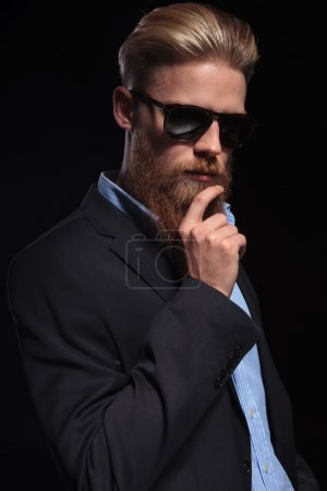 pensive bearded business man