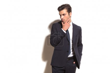 elegant business man thinking and looks away to  side