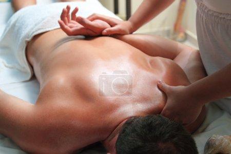 Handsome man getting massage