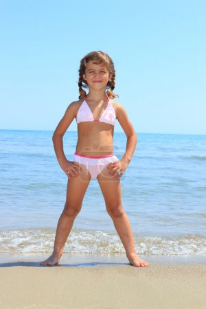 Photo for Little cute girl on the beach in Greece - Royalty Free Image
