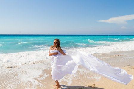Beautiful Girl With White fabric on The Beach.