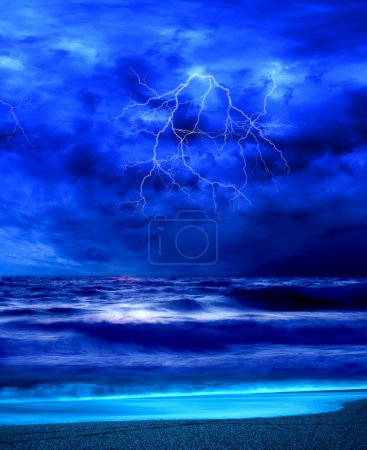 Lightning flashes across the beach from a storm