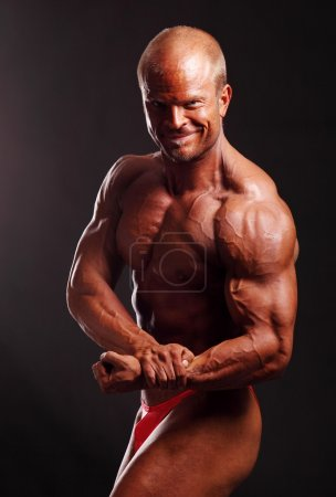 Photo for Muscular male bodybuilder posing in studio - Royalty Free Image