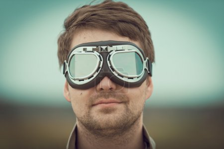Young man wearing aviator goggles