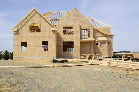large two story family home under construction