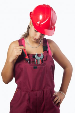 Woman mechanic with hard hat and in overalls isolated on white