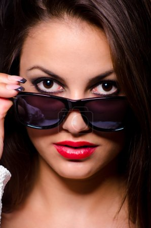 Portrait of the beautiful girl with sunglasses