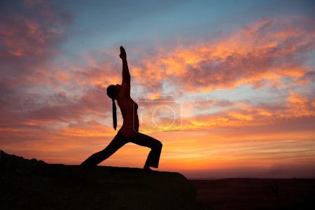 Outdoor sunrise yoga girl