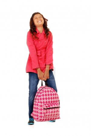 School girl child struggling with heavy backpack