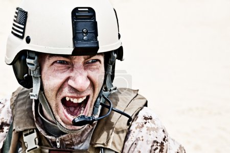 Scary face of US marine in the marpat uniform show...