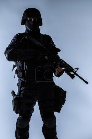 SWAT officer backlit