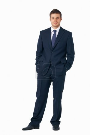 Photo for Full length portrait of a young businessman standing with his hands in the pockets. - Royalty Free Image