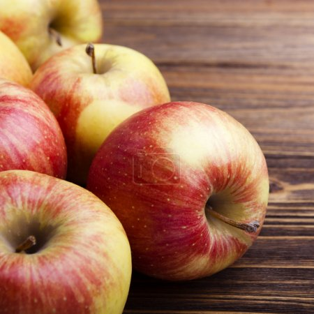 Photo for Red apples on wooden table - Royalty Free Image