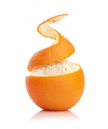 Orange with peeled spiral skin isolated on white b...