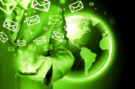 Photo for Business man holding smart phone and sending emails - Royalty Free Image