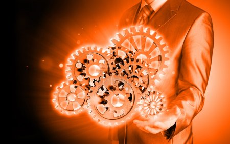 Photo for Businessman hand touching gears to success as concept - Royalty Free Image