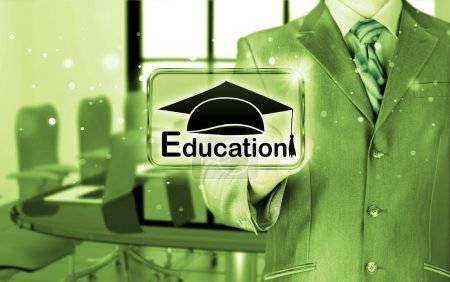 Businessman pointing 'education' sign
