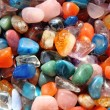 Different color gemstones as luxury minerals background